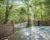 Eastern-Ornamental-Gate-with-Walnut-Illusions-Fence